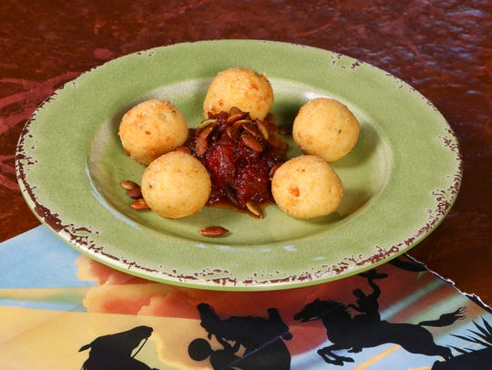 Goat cheese balls with tomato jam from Elote Cafe in