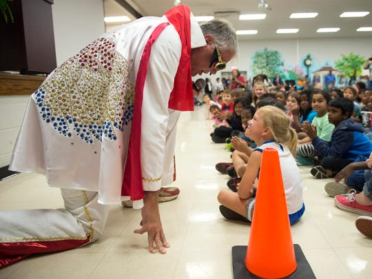 Collierville Schools superintendent John Aitken sings to first-grader Ella Shropshire, 6, while performing as Elvis Presley during Immersion Day at Sycamore Elementary School on Oct. 28. Collierville Schools was named a Top Workplaces 2016 award winner in the education category.