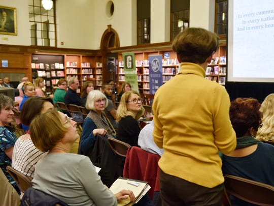 Attendees listen as Jan Herrold, former board member for York Hospital and Wellspan Health, asks a question of the panel during the York City Community Health Conversation Thursday at Martin Library.