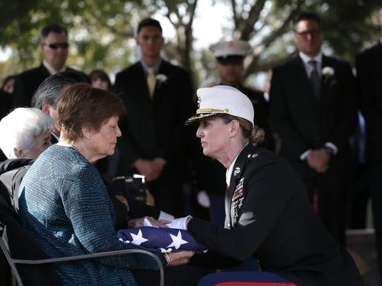 Lucia Hernandez receives the casket flag from her husband