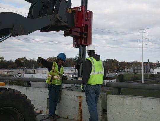 Russ Morgan, left, and Joe Vanderpoel work on a project