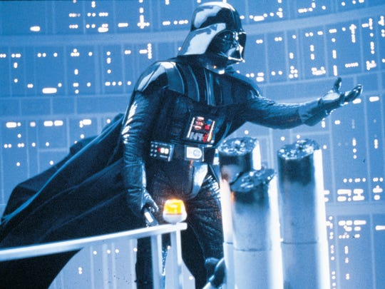 "Darth Vader (voiced by James Earl Jones) beckons Luke Skywalker in a scene from ""The Empire Strikes Back"" (1980)."