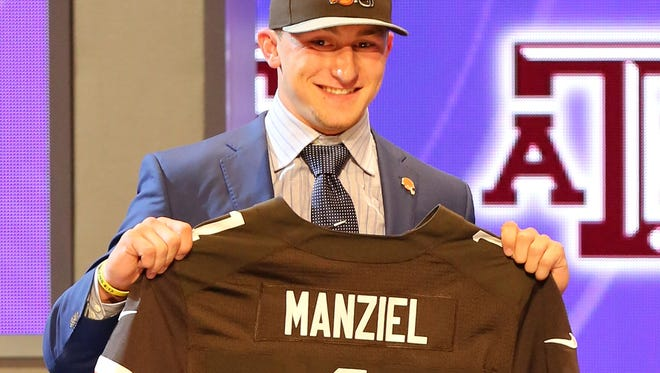 Johnny Manziel poses with his jersey after being selected by the Cleveland Browns at the 2014 NFL Draft at Radio City last week in New York. Manziel's jersey has taken over as the top seller in the NFL.