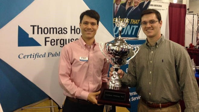 Thomas Howell Ferguson accepts the Corporate Cup Challenge trophy.
