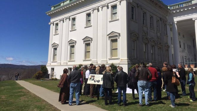 A tour group stands outside Mills Mansion and listens to two World War I reenactors. The 100th anniversary of America's entry into the war was Thursday.