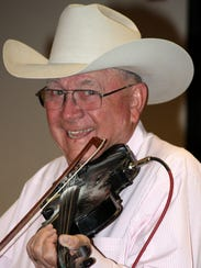 Joe Delk's fiddle helped fill the dance fllor at the