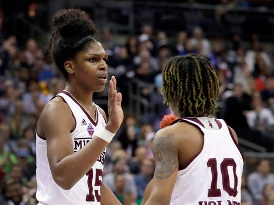 Mississippi State's Teaira McCowan, left, is congratulated by teammate Jazzmun Holmes (10) after a block during the first half against Notre Dame in the final of the women's NCAA Final Four college basketball tournament, Sunday, April 1, 2018, in Columbus, Ohio. (AP Photo/Tony Dejak)