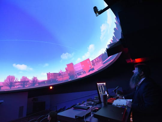 Michael Stamatikos, assistant professor of physics and astronomy at Ohio State University-Newark, projects a 360-degree image of the Works courtyard on to the museum's new SciDome during a preview day on Tuesday, June 5, 2018. Stamatikos will serve as The Works' chief science officer.