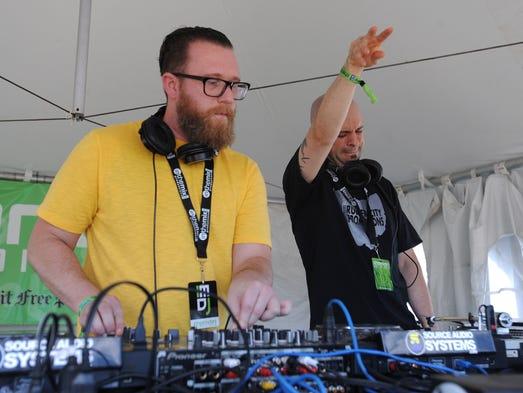 DJs Mark Roscoe, left, and Ricky Spanish crank out