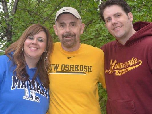 Capelle family 3 grads.jpg