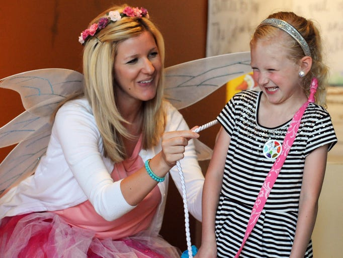 Shasta Buckley, a dental assistant with Pediatric Dental Group of Hattiesburg, left, shows children how to floss with the help of Hayden Bowman, 6, Tuesday during a FestivalSouth Artie Event for Kids at Main Street Books in downtown Hattiesburg.
