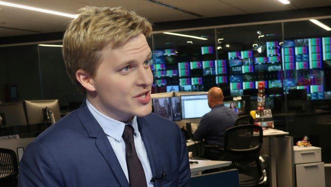 Ronan Farrow, a contributing writer for the New Yorker, speaks with reporters at Associated Press headquarters in New York.