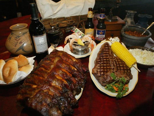 "Cattleman's Steakhouse in Fabens, TX offers its ""Half a cow"" rack of ribs, Cowboy two-pound porterhouse steak, sides include their famous pineapple-laced cole slaw, ranch-style beans and dinner rolls and guests can start their meal with a shrimp cocktail."