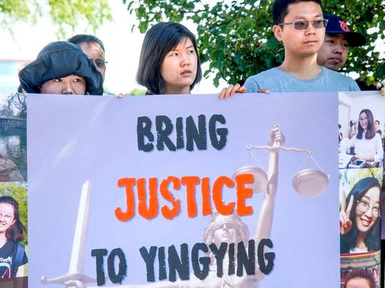 People line up outside the federal courthouse for first appearance of Brendt Christensen, the suspect in the kidnapping of Yingying Zhang, a Chinese scholar at the University of Illinois, Monday, July 3, 2017 in Urbana, Ill, During the nine-minute hearing, Christensen did not speak other than to acknowledge to the federal judge that he understood his rights. U.S. Magistrate Eric Long ordered Christensen held without bond. (Robin Scholz/The News-Gazette via AP)