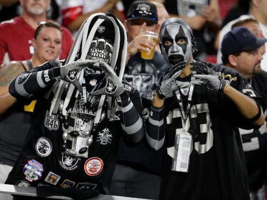 Oakland Raiders fans cheer during the first half of