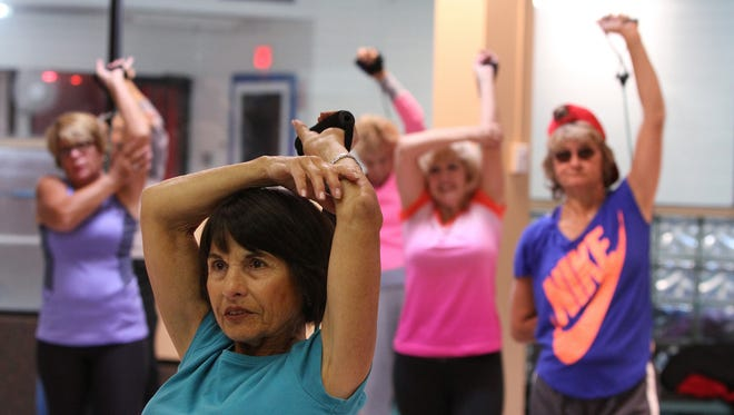 Amy Ullery of Wayside participates in a sculpting exercise class at Shore Fit Club and Spa in Oakhurst, NJ Monday October 19, 2015.