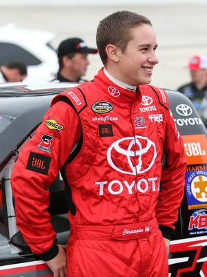 May 13, 2016; Dover, DE, USA; NASCAR Camping World Truck Series driver Christopher Bell stands by his truck prior to the JACOB Companies 200 at Dover International Speedway. Mandatory Credit: Matthew O'Haren-USA TODAY Sports