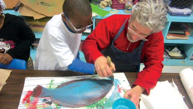 ArtsWestchester Teaching Artist Jo Mullins works on an art project with a student at Longfellow Middle School.
