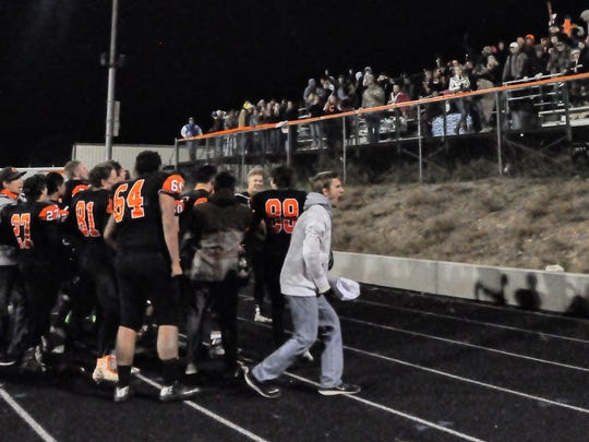 The Capitan Tigers celebrate their win with fans at the packed Tiger Stadium after the game Nov. 25.