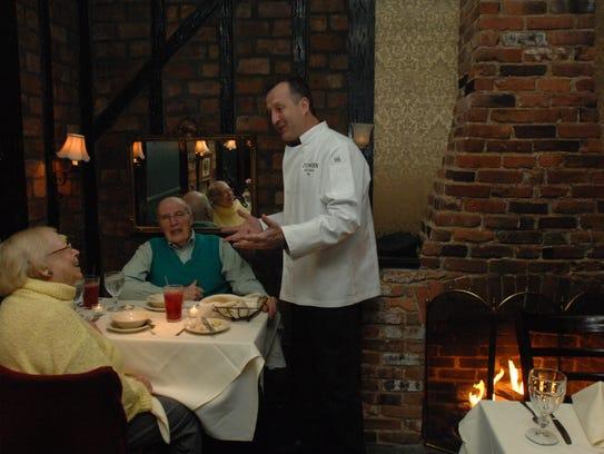 Ivy Inn  owner chef Jack Zaorski  talking with customers