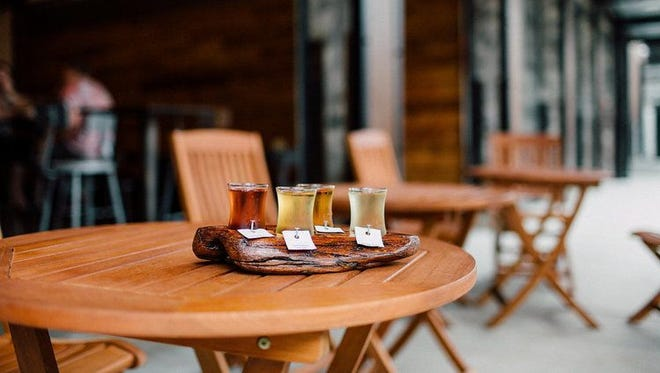 1859 Cider Co. serves a flight in its alley cider house.