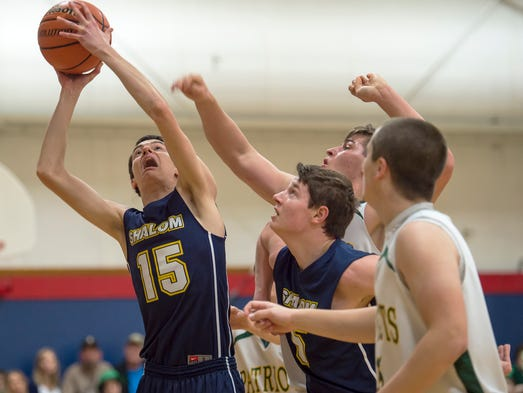 Shalom's Daniel Sowers takes a shot at the basket while