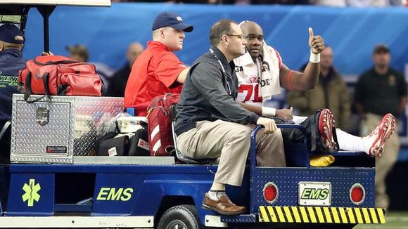 Ole Miss left tackle Laremy Tunsil leaves the field after suffering an apparent broken leg in the Peach Bowl.