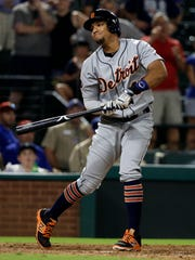 Tigers second baseman Dixon Machado gestures with the bat after striking out with the bases loaded for the final out in the ninth inning of the Tigers' 6-2 loss to the Rangers on Monday, Aug. 14, 2017, in Arlington, Texas.