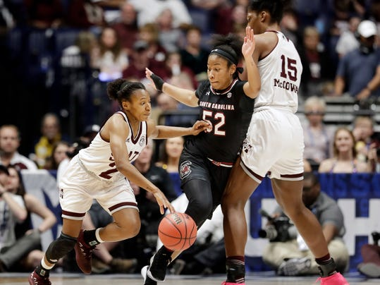 Mississippi State's Morgan William (2) drives against South Carolina's Tyasha Harris (52) as Mississippi State's Teaira McCowan (15) sets a pick in the second half of an NCAA college basketball championship game at the women's Southeastern Conference tournament Sunday, March 4, 2018, in Nashville, Tenn. (AP Photo/Mark Humphrey)