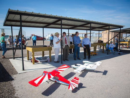 Visitors and city officials, including Las Cruces Mayor Pro Tem Greg Smith, second from left, attend the opening of the new Model Airplane and Archery Facility, April 22, 2016.