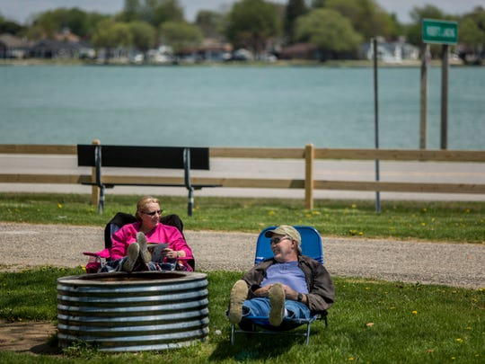 Candy and Greg Dault, of Muskegon, relax in the sun