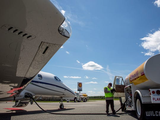 Aviation Express employee Scott Wilson fuels a corporate jet before its departure for New York Wednesday, June 8, 2016 at the St. Clair County International Airport.