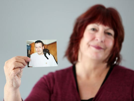 Judy Wooldridge holds a photograph of her autistic son Ben Wooldridge, who was hit and killed by a train in Albany in 2013. Wooldridge and others met with the Statesman Journal on Friday, July 22, 2016, to discuss the LEDS system, a new database that allows law enforcement statewide to share medical and mental health information.