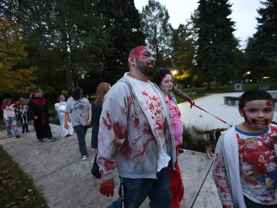 Participants walk down Court Street during the annual Salem Zombie Walk on Saturday, Oct. 22, 2016.