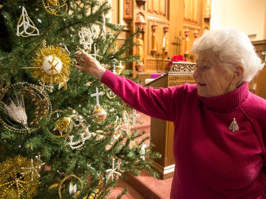 Doris Rohlfer fixes some of the handmade Chrismon ornaments that decorate the Christmas tree at Bethel United Church of Christ on Friday morning.
