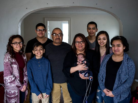 The Medrando family from left, Jasmine, 17, Christian, 10, Joshua, 15, Raymond Jr., JoAnn and Raymond III, Joey, 18, Nicole, 19, and Ashley, 16.
