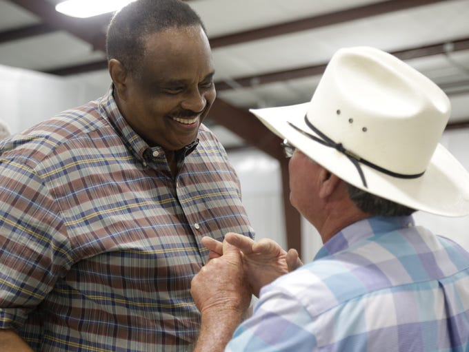 Jefferson County dairyman Ronnie Walker (Right) greets