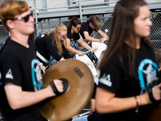 The Gulf Coast High School drumline performs during