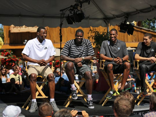 New Minnesota Timberwolves NBA basketball players, from left, Andrew Wiggins, Anthony Bennett, Thaddeus Young, Zach LaVine attend a news conference at the Minnesota State Fair on Tuesday, Aug. 26, 2014, in Falcon Heights, Minn. (AP Photo/Star Tribune, Brian Mark Peterson)