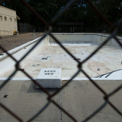 The Walton Street pool sits empty and closed on the south side of Asheville in Walton Street Park. Community members in the area want the city to reopen the pool.
