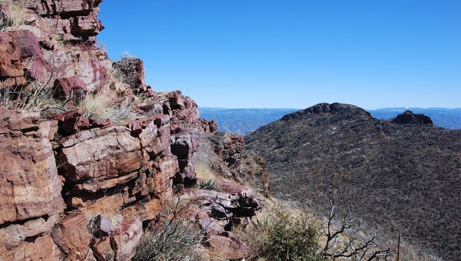 Red cliffs below Mazatzal Peak on the strenuous Y Bar Trail in Tonto National Forest.