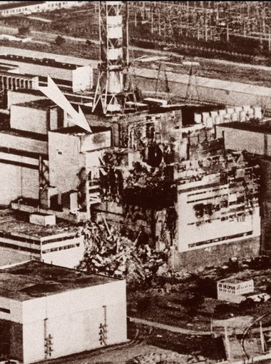 This May 9, 1986 file photo shows the stricken reactor No. 2 of the Ukrainian nuclear power plant of Chernobyl, after the explosion causing severe damages and radioactive fall out that spread all over Europe. Ukraine's Health Minister Andry Serduik said April 22 that more than 12,500 people put to work clearing up the reactor explosion had died since the disaster. It was the first time such a major figure expressed himself, and foreign experts were quick to shed doubt on it.