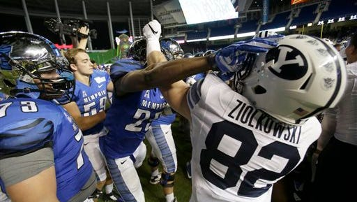 Players scuffle after Memphis defeated Brigham Young, 55-48 in double overtime during the inaugural Miami Beach Bowl football game, Monday, Dec. 22, 2014 in Miami.