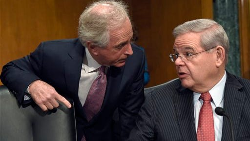 Senate Foreign Relations Committee Chairman Sen. Bob Corker, R-Tenn., left, talks with the committee's ranking member Sen. Robert Menendez, D-N.J. on Capitol Hill in Washington.