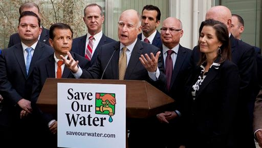 Gov. Jerry Brown talks during a news conference after meeting with several California mayors to discuss water conservation at the Capitol in Sacramento, Calif., on Tuesday, April 28, 2015. Gov. Brown called for $10.000 fines for residents and businesses that waste the most water as California cities try t o meet mandatory conservation targets during the drought. (AP Photo/Steve Yeater)