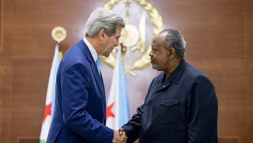 "U.S. Secretary of State John Kerry, left, and Djiboutian President Ismail Omar Guelleh shake hands as they greet each other at the Presidential Palace, Wednesday, May 6, 2015, in Dijbouti, Dijbouti. Kerry said Wednesday he intends to discuss with Saudi Arabian officials how to implement a ""humanitarian pause"" in Yemen's civil war, citing increased shortages of food, fuel and medicine that are adding to a crisis that has already caused some thousands of people to flee to neighboring countries. Kerry is also visiting Sri Lanka, Somalia,  France, and Saudi Arabia on his trip.(AP Photo/Andrew Harnik, Pool)"