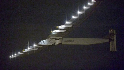 FILE - In this Monday, June 29, 2015, file photo, the Solar Impulse 2 flies over Nagoya Airport after taking off in Toyoyama, near Nagoya, central Japan. The solar-powered plane, journeying around the world without fuel, depending on the weather is expected to land in Hawaii early Friday morning, July 3, 2105.(Kyodo News via AP, File) JAPAN OUT, MANDATORY CREDIT