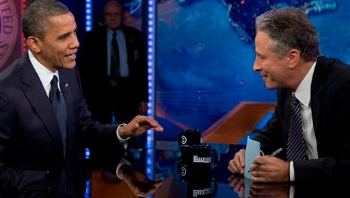 "In this Oct. 18, 2012 file photo, President Barack Obama talks with Jon Stewart during a taping of his appearance on ""The Daily Show with John Stewart"", in New York. Stewart enters the home stretch of his 16 years on Comedy Central's ""The Daily Show"" on Monday, July 20, 2015, with 12 more nights of jokes at the expense of those who make and report the news before he signs off for good on Aug. 6, 2015. (AP Photo/Carolyn Kaster, File)"