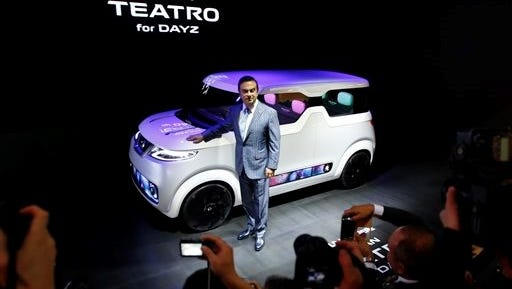 Nissan Motor Co. President and CEO Carlos Ghosn unveils Nissan's electric concept vehicle TEATRO for DAYS during the media preview for the Tokyo Motor Show in Tokyo, Wednesday, Oct. 28, 2015. The biennial exhibition of vehicles in Japan runs for the public from Friday, Oct. 30.