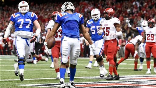 Louisiana Tech running back Kenneth Dixon, center, celebrates a second half touchdown against Arkansas State in the New Orleans Bowl NCAA college football game Saturday, Dec. 19, 2015, in New Orleans. (AP Photo/Parker Waters)